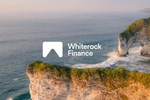 Whiterock Finance logo with a coastline background